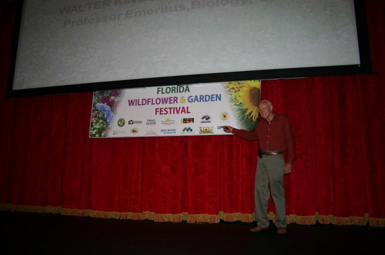 Quality Green President & Co-owner Dana Venrick speaking at the Wildflower Festival.